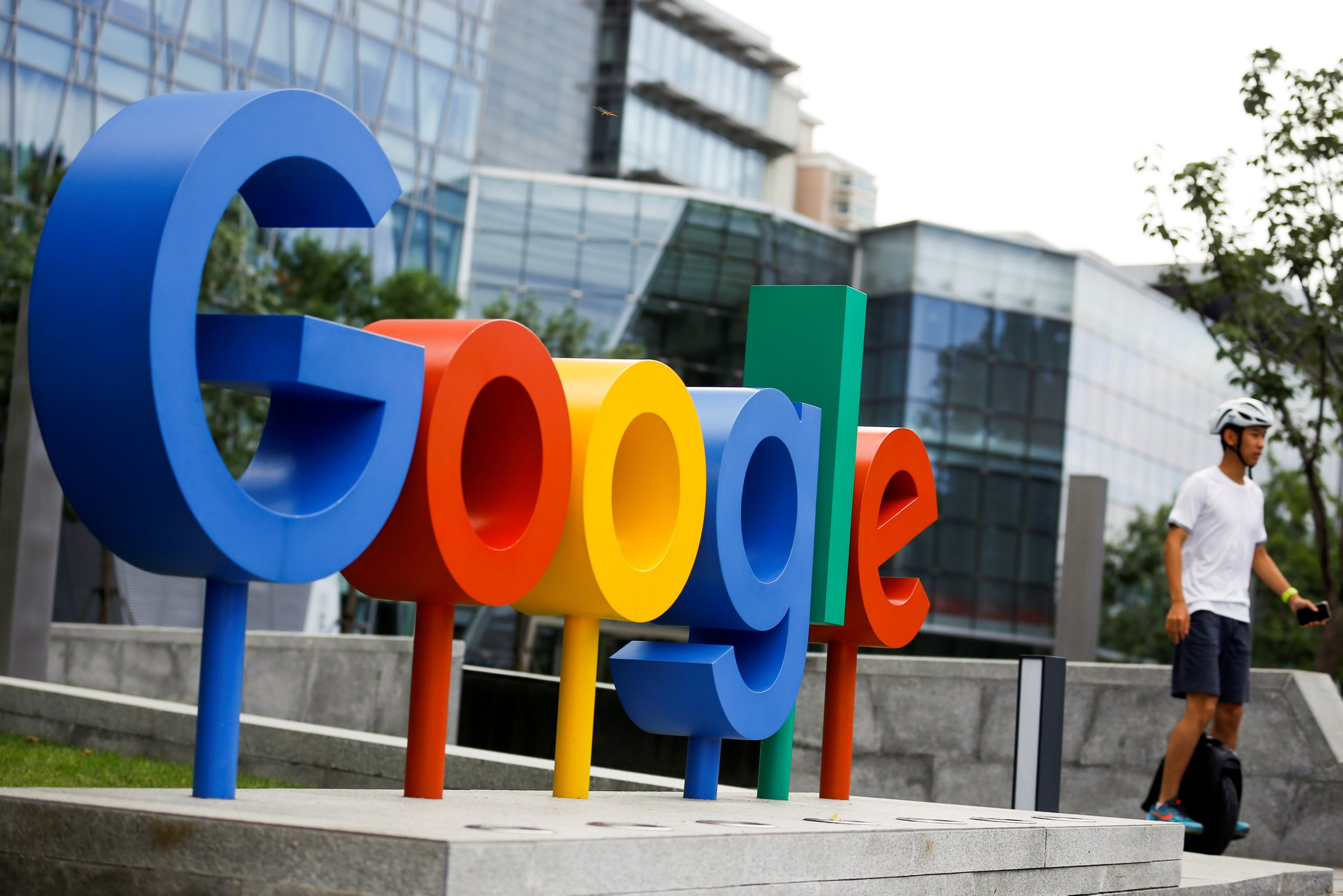 FILE PHOTO: The brand logo of Alphabet Inc's Google is seen outside its office in Beijing, China, August 8, 2018. REUTERS/Thomas Peter/File Photo
