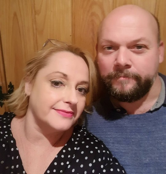 PIC FROM Kennedy News and Media (PICTURED: SHARON PARRETT, 47, WITH HUSBAND TIM WHO DREW MAN AND BUILDING BASED ON HER DESCRIPTIONS) A mum claims her consistent bad luck is punishment for killing someone in a past life - and her husband has sketched the 'black male murderer' she used to be. Sharon Parrett, from Cork, Ireland, believes she was a black man from New Orleans in a former life thanks to a recurring dream of being him for the last 40 years. The 47-year-old mum-of-two's husband Tim Parrett, 46, has even drawn a detailed sketch of the unknown male in the hope to discover who Sharon might have been. SEE KENNEDY NEWS COPY - 0161 697 4266