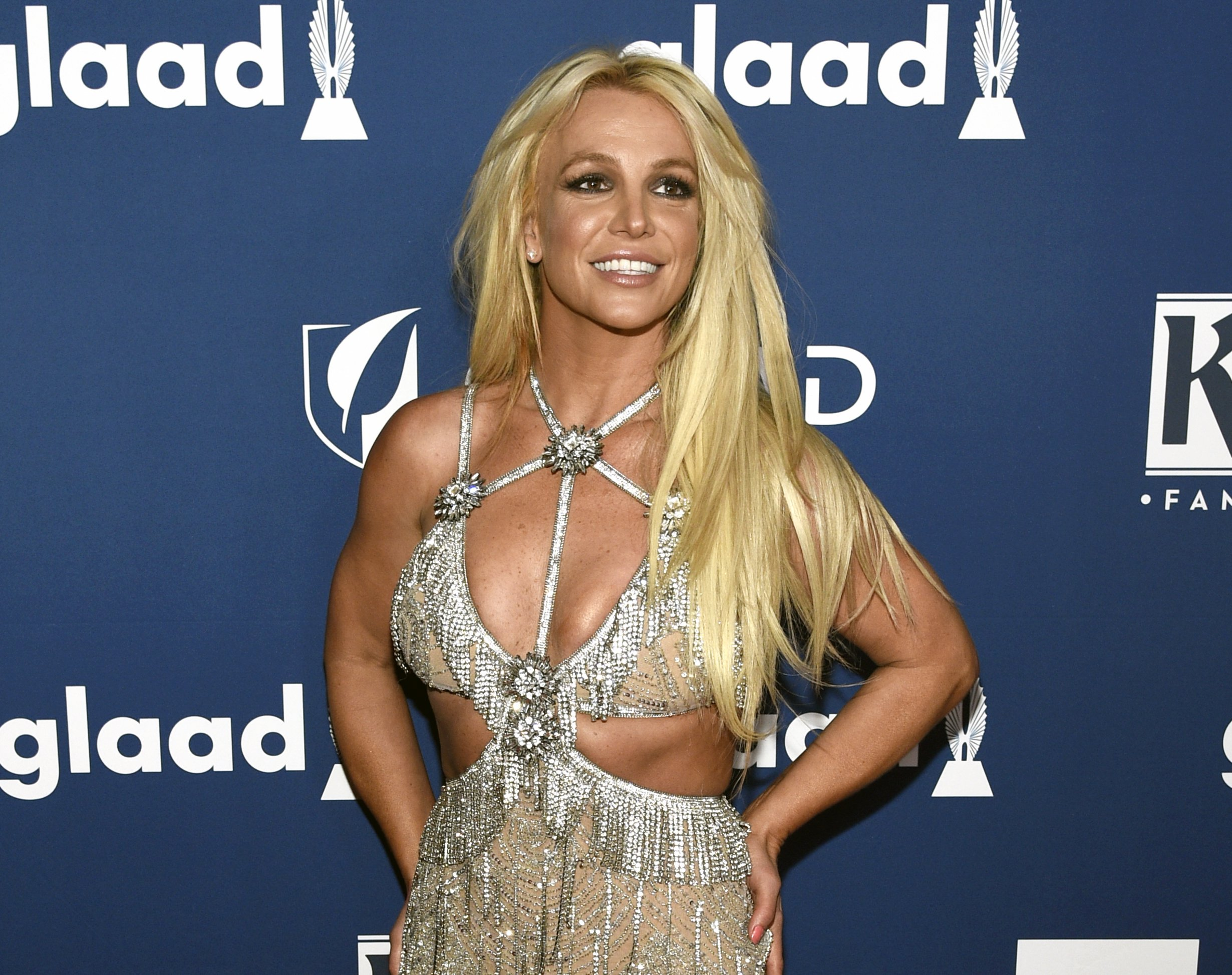 FILE - In this April 12, 2018 file photo, Britney Spears arrives at the 29th annual GLAAD Media Awards in Beverly Hills, Calif. Spears is putting her planned Las Vegas residency on hold to focus on her father's recovery from a recent life-threatening illness. The pop superstar announced Friday, Jan. 4, 2019 she is going on an indefinite work hiatus. (Photo by Chris Pizzello/Invision/AP, File)
