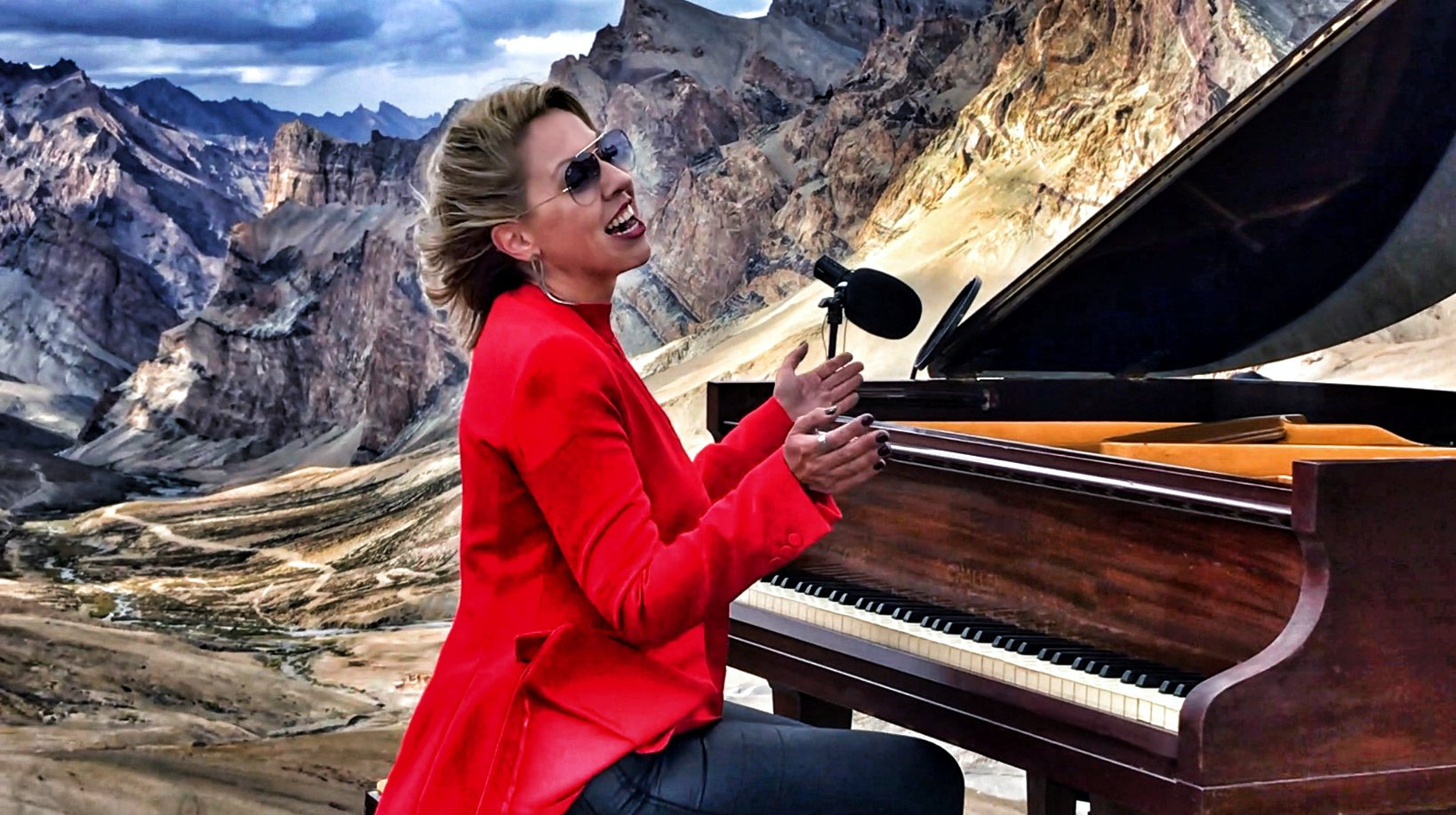 Pianist Evelina De Lain, 41, breaks records as she performs a classical concert ? 5,000 metres high in the Himalayas. See SWNS story SWOCpiano; An impressive feat for anyone, the London-based composer's triumph was even more notable after losing proper function of her hands when she developed repetitive strain injury, chronic tendonitis and polyarthritis in her finger joints. She was diagnosed in 1995 and doctor's later warned her condition was incurable and, after years of practising for up to 12 hours a day, she may never be able to play properly again. However, determined Evelina started intensive therapy and has now gained back 70% use of her hands ? and created her very own mixed style of classical and jazz music.