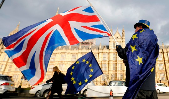 (FILES) In this file photo taken on March 28, 2018 An anti-Brexit demonstrator waves a Union flag alongside a European Union flag outside the Houses of Parliament in London on March 28, 2018. - Britain's battle over Brexit resumes on January 7, 2019 when parliament returns from its Christmas break to debate and -- most likely -- defeat Prime Minister Theresa May's unpopular EU divorce deal. (Photo by Tolga AKMEN / AFP)TOLGA AKMEN/AFP/Getty Images