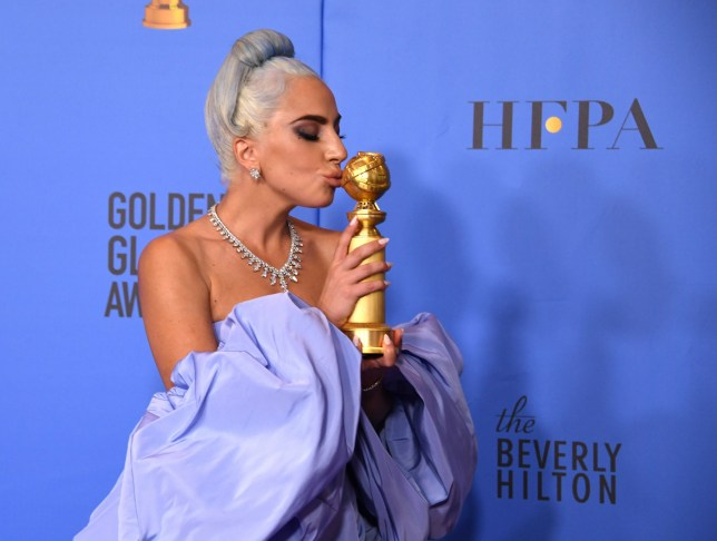 "TOPSHOT - Winner for Best Original Song - Motion Picture for ""Shallow - A Star is Born"" Lady Gaga poses with the trophy during the 76th annual Golden Globe Awards on January 6, 2019, at the Beverly Hilton hotel in Beverly Hills, California. (Photo by Mark RALSTON / AFP)MARK RALSTON/AFP/Getty Images"