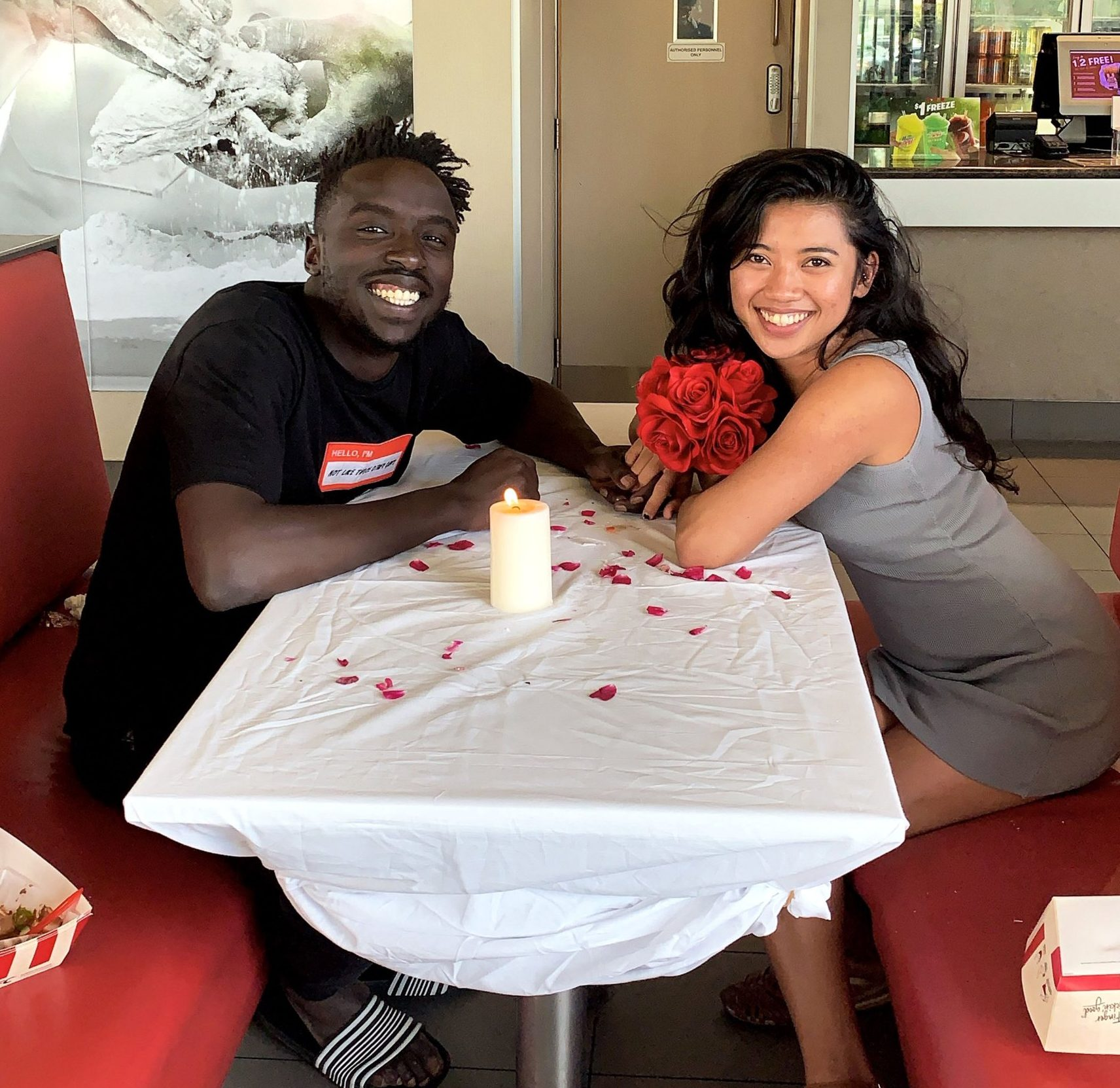 PIC FROM Emmanuel Kei/Caters News - (PICTURED: Emmanuel Kei, 23, with his girlfriend Diane Del, 26, in in Adelaide, South Australia late last month [21 DECEMBER].) - A romantic boyfriend has taken his partners love of fried chicken to the extreme by surprising her with a fancy dinner date at KFC complete with candles, rose petals and table service.Forget about the Colonels top secret 11 herbs and spices Australian heartthrob Emmanuel Kei has discovered the ultimate secret for spicing up his love life: a romantic dinner date at KFC.SEE CATERS COPY
