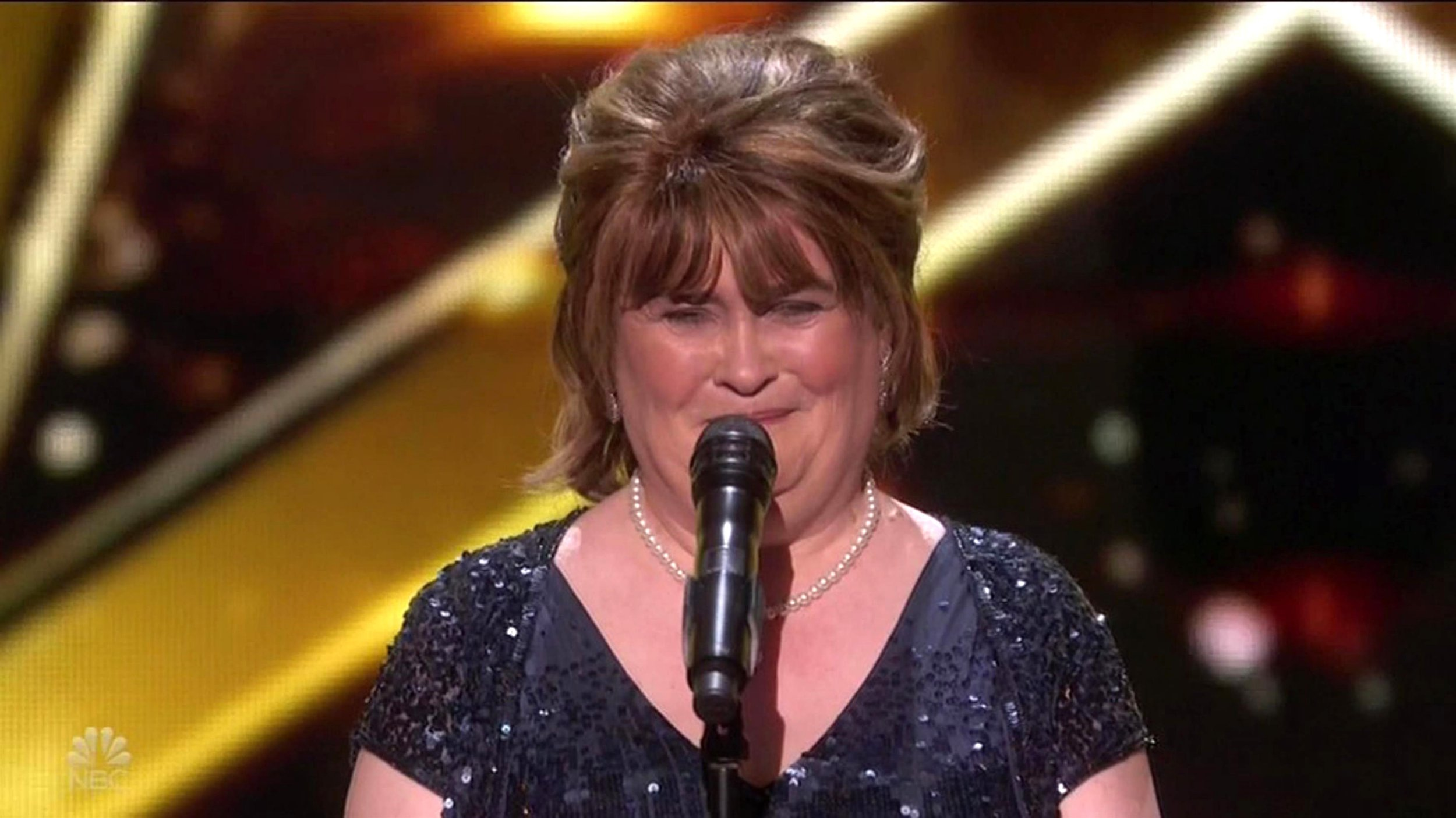"BGUK_1451429 - ** RIGHTS: WORLDWIDE EXCEPT IN UNITED STATES ** Los Angeles, CA - Susan Boyle gets Golden Buzzer and advances straight to the finals as she appears on America's Got Talent: The Champions. The Scottish singer first wowed on Britain's Got Talent almost ten years ago - and she proved she's still got the talent to wow the judges when she appeared on the new show in the US - as she got the Golden Buzzer as the first through to the finals. The new spin-off show brought 50 of the top performers worldwide from the franchise's history, with Simon Cowell saying: ""It's like the Olympics: the best of the best. You're not just taking on America, you're taking on the world."" Boyle was by far the most anticipated performer as the first 10 champions performed, getting rapturous applause and ovations as soon as she took the stage. Cowell looked genuinely moved to once again see the singer who became a worldwide viral phenomenon thanks to her performance of I Dreamed A Dream on Britain's Got Talent in 2009. ""And what's your name?"" Simon smiled, telling her: ""Oh my God this brings back so many great memories having you back. Genuinely, I'm beyond thrilled that you're here tonight."" The audience appeared enraptured during her ballad-style version of The Rolling Stones classic Wild Horses. ""I can't think of any other contestant who has defined this show better than you. You're the one. You made a huge difference to a lot of people's lives and I'm absolutely thrilled that you're here,"" Cowell told her .Mel B added: ""I want to be the woman that gives you something that you deserve."" The Spice Girls star then jumped up to press the Golden Buzzer sending her through, with Boyle looking stunned as gold confetti fell around her. Cowell followed Mel in running up onstage to hug her, telling Boyle as he pointed to the ovations: ""I'm so proud of you. You sounded amazing. Look at that."" Boyle finally said she was 'very happy and very humble,' adding ""Thank you all very much."" *BACKGRID DOES NOT CLAIM ANY COPYRIGHT OR LICENSE IN THE ATTACHED MA Pictured: Susan Boyle BACKGRID UK 7 JANUARY 2019 BYLINE MUST READ: NBC / BACKGRID *BACKGRID DOES NOT CLAIM ANY COPYRIGHT OR LICENSE IN THE ATTACHED MATERIAL. ANY DOWNLOADING FEES CHARGED BY BACKGRID ARE FOR BACKGRID'S SERVICES ONLY, AND DO NOT, NOR ARE THEY INTENDED TO, CONVEY TO THE USER ANY COPYRIGHT OR LICENSE IN THE MATERIAL. BY PUBLISHING THIS MATERIAL , THE USER EXPRESSLY AGREES TO INDEMNIFY AND TO HOLD BACKGRID HARMLESS FROM ANY CLAIMS, DEMANDS, OR CAUSES OF ACTION ARISING OUT OF OR CONNECTED IN ANY WAY WITH USER'S PUBLICATION OF THE MATERIAL* UK: +44 208 344 2007 / uksales@backgrid.com USA: +1 310 798 9111 / usasales@backgrid.com *UK Clients - Pictures Containing Children Please Pixelate Face Prior To Publication*"
