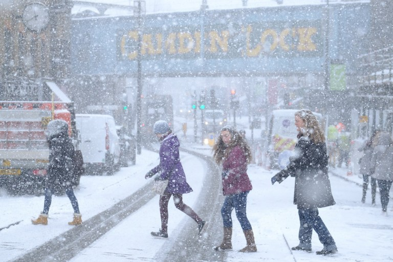 "People cross the road in Camden during a snow blizzard in London, United Kingdom, on February 28, 2018. Siberian winds continue to blow the ""Beast from the East"" across the country and Storm Emma threatens to bring more snow in the coming days. (Photo by Alex Milan Tracy/Sipa USA)"