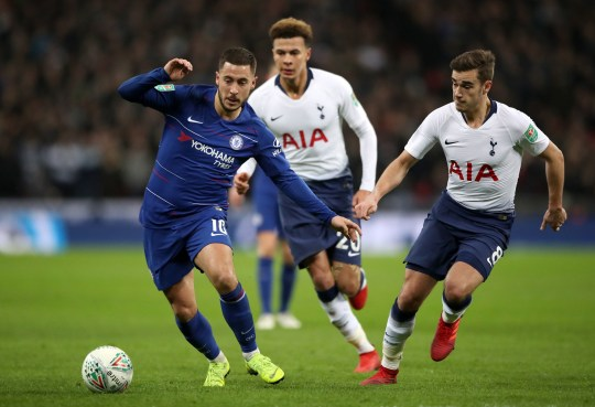 """Chelsea's Eden Hazard (left) and Tottenham Hotspur's Harry Winks in actioni during the Carabao Cup, semi final match at Wembley, London. PRESS ASSOCIATION Photo. Picture date: Tuesday January 8, 2019. See PA story SOCCER Tottenham. Photo credit should read: Nick Potts/PA Wire. RESTRICTIONS: EDITORIAL USE ONLY No use with unauthorised audio, video, data, fixture lists, club/league logos or """"live"""" services. Online in-match use limited to 120 images, no video emulation. No use in betting, games or single club/league/player publications."""