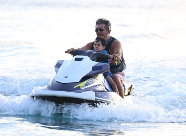 Simon Cowell and Lauren Silverman are pictured at the beach with son Eric in Barbados. 09 Jan 2019 Pictured: Simon Cowell, Lauren Silverman. Photo credit: MEGA TheMegaAgency.com +1 888 505 6342