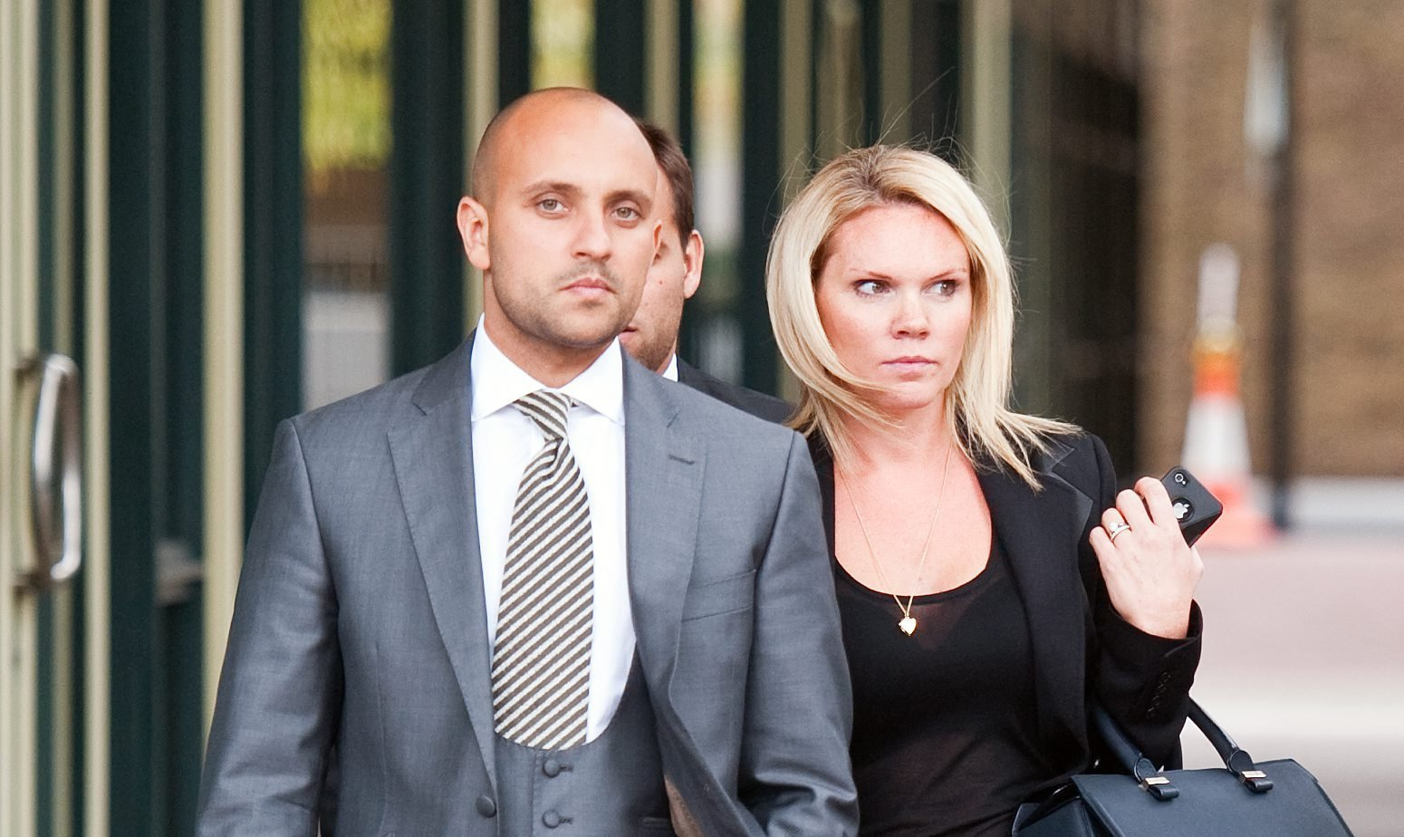 FILE PHOTO - Louise Flood (centre) the sister of Victoria Beckham leaves an employment tribunal in London with her husband Darren Flood (left, foreground). September 7 2011.See National News story NNbecks.David Beckham?s former brother-in-law faces up to six years in jail after his firm wined and dined investors and fleeced them of their savings in an ?800,000 boiler room fraud.The former husband of Victoria Beckham?s sister, Darren Flood found elderly people to lure into buying worthless ?rare earth metals? as a director of The Commodities Link. His cronies ?made great play? of his ties to the former England football captain to gain victims? trust and even planned scamming the dad of ex-Chelsea midfielder Joe Cole.They pushed OAPs into the scheme with lavish meals and promised a 300 per cent return on their investments but ignored them when they tried to cash out.
