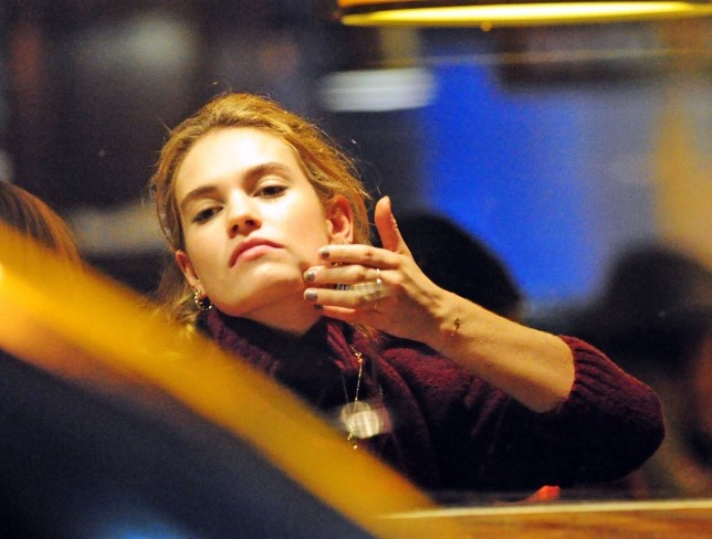 BGUK_1452842 - London, UNITED KINGDOM - *PREMIUM-EXCLUSIVE* - MUST CALL FOR PRICING BEFORE USAGE - Are Actors Matt Smith and Lily James Engaged? Lily is pictured wearing Gold Band on engagement Finger while enjoying Night out in Soho together. The Happy couple were seen looking very relaxed as Matt checked out some Spots on Lily's Face and while doing this she revealed a Gold ring band on her engagement finger!!!! *PICTURES TAKEN ON 09/01/2019* Pictured: Lily James BACKGRID UK 11 JANUARY 2019 BYLINE MUST READ: NASH / BACKGRID UK: +44 208 344 2007 / uksales@backgrid.com USA: +1 310 798 9111 / usasales@backgrid.com *UK Clients - Pictures Containing Children Please Pixelate Face Prior To Publication*