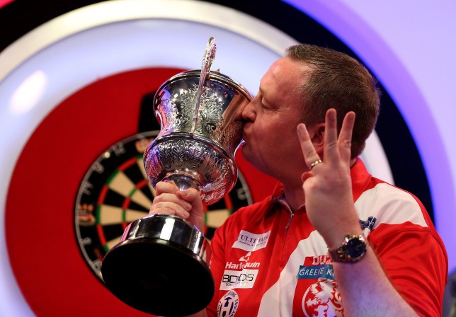 Glen Durrant celebrates winning with the trophy after 3 titles in a row during day nine of the BDO World Professional Darts Championship 2019 at The Lakeside, London. PRESS ASSOCIATION Photo. Picture date: Sunday January 13, 2019. See PA story DARTS London. Photo credit should read: Steven Paston/PA Wire