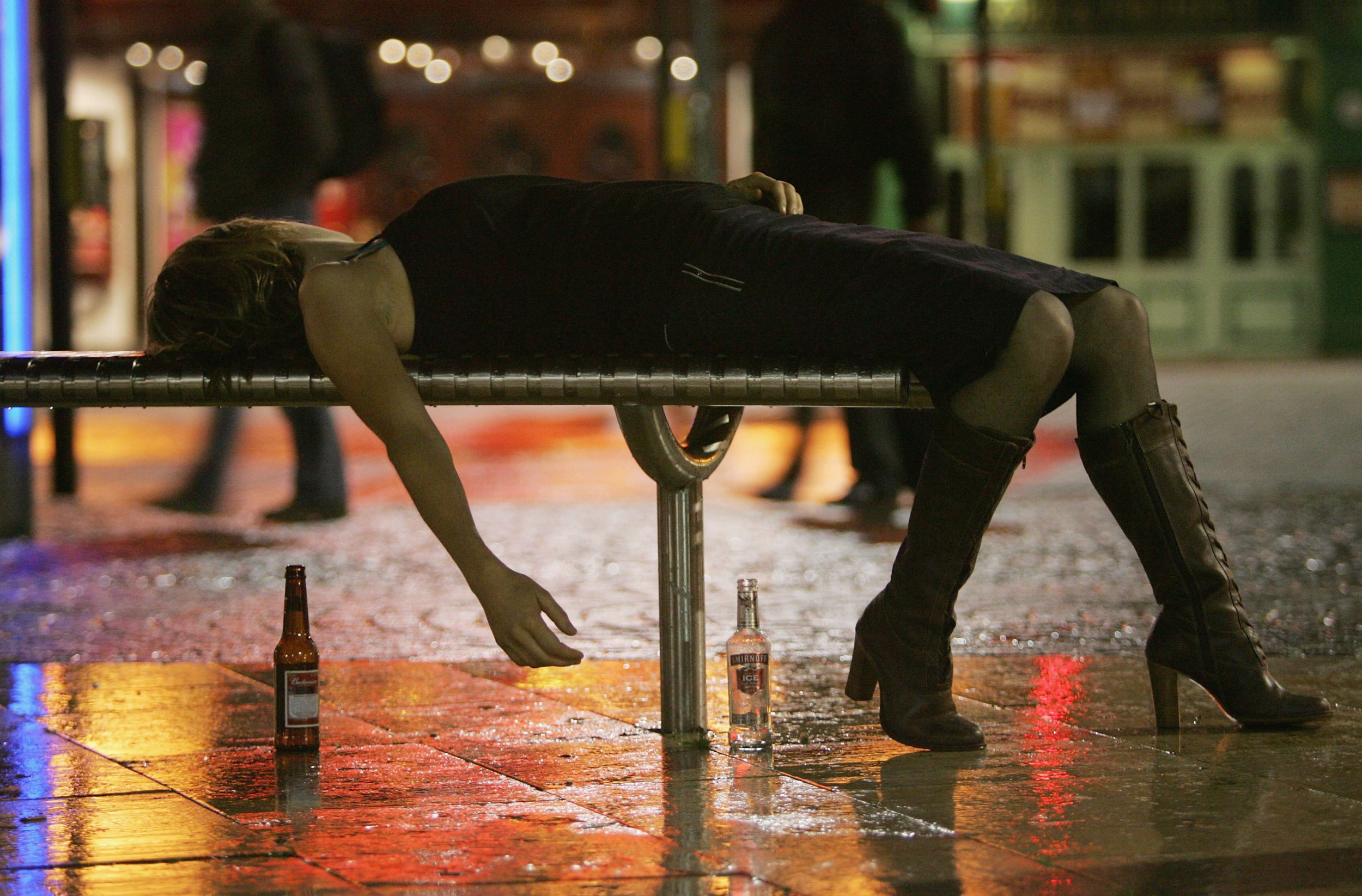 BRISTOL, ENGLAND - OCTOBER 15: A woman lies on a bench after leaving a bar in Bristol City Centre on October 15, 2005 in Bristol, England. Pubs and clubs are preparing for the new Licensing laws due to come into force on November 24 2005, which will allow pubs and clubs longer and more flexible opening hours. Opponents of the law believe this will lead to more binge-drinking with increased alcohol related crime, violence and disorder while health experts fear an increase in alcohol related illnesses and alcoholism. (Photo by Matt Cardy/Getty Images)