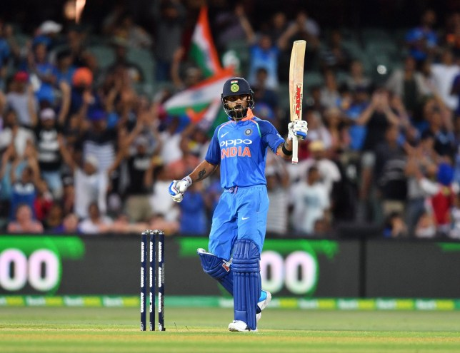 epa07285875 Virat Kohli of India raises his bat after scoring 100 runs during the Second One-Day International (ODI) match between Australia and India at the Adelaide Oval in Adelaide, Australia, 15 January 2019. EPA/DAVID MARIUZ EDITORIAL USE ONLY, NO USE IN BOOKS, NEWS REPORTING PURPOSES ONLY AUSTRALIA AND NEW ZEALAND OUT