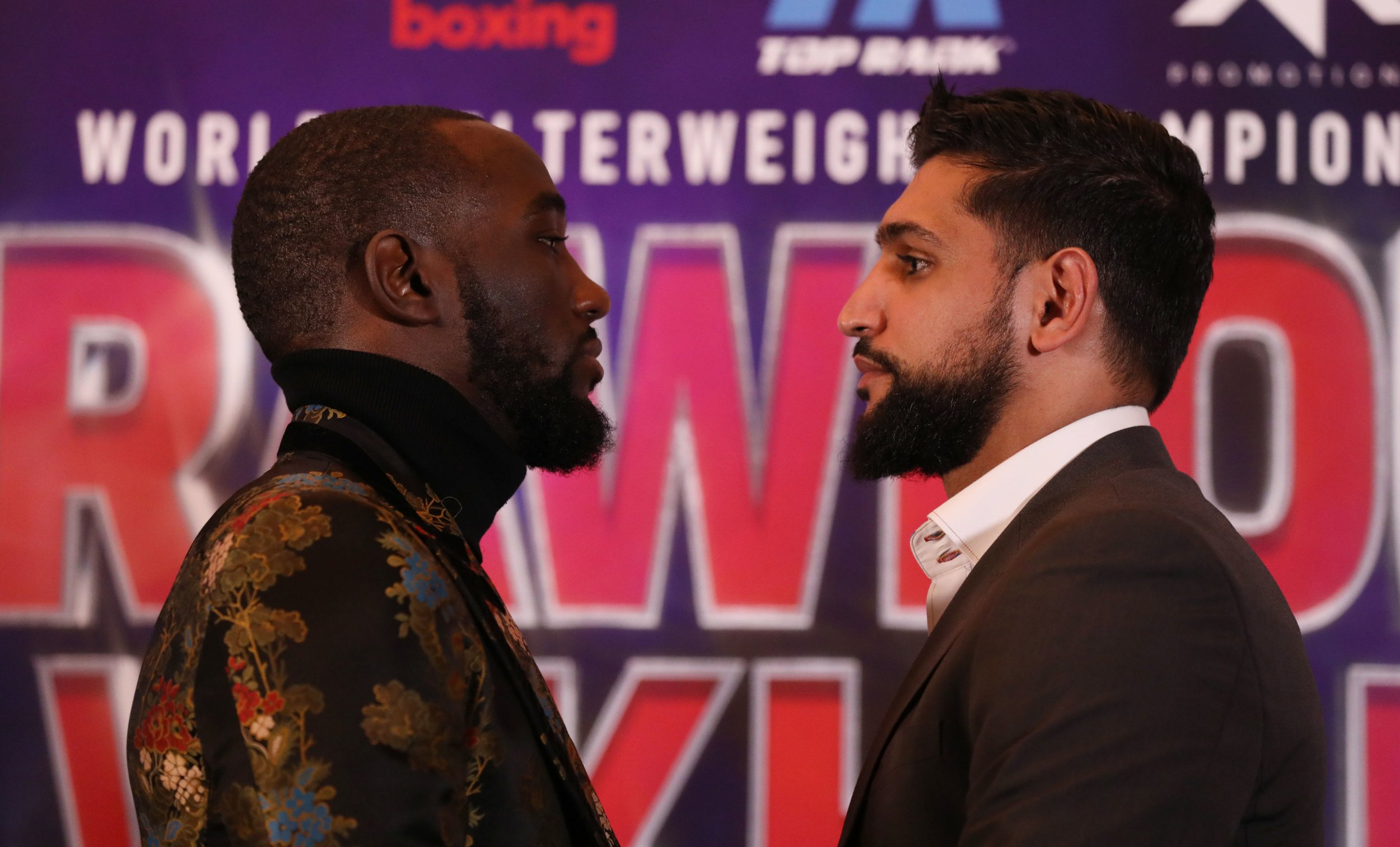 Terence Crawford (left) and Amir Khan during the press conference at The Landmark London Hotel, London. PRESS ASSOCIATION Photo. Picture date: Tuesday January 15, 2019. See PA story BOXING Khan. Photo credit should read: Isabel Infantes/PA Wire