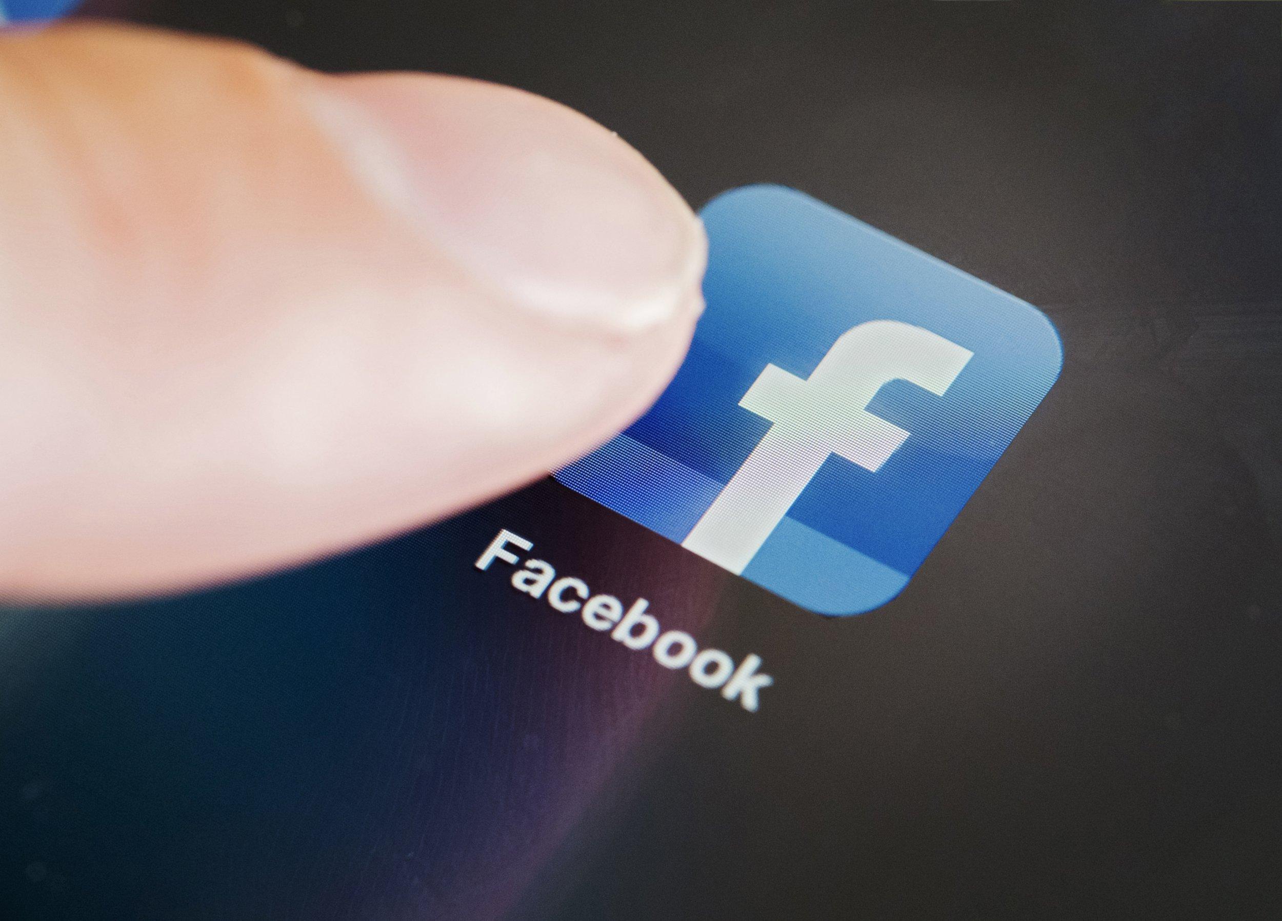 Detail of Facebook social media app icon on iPad tablet computer screen