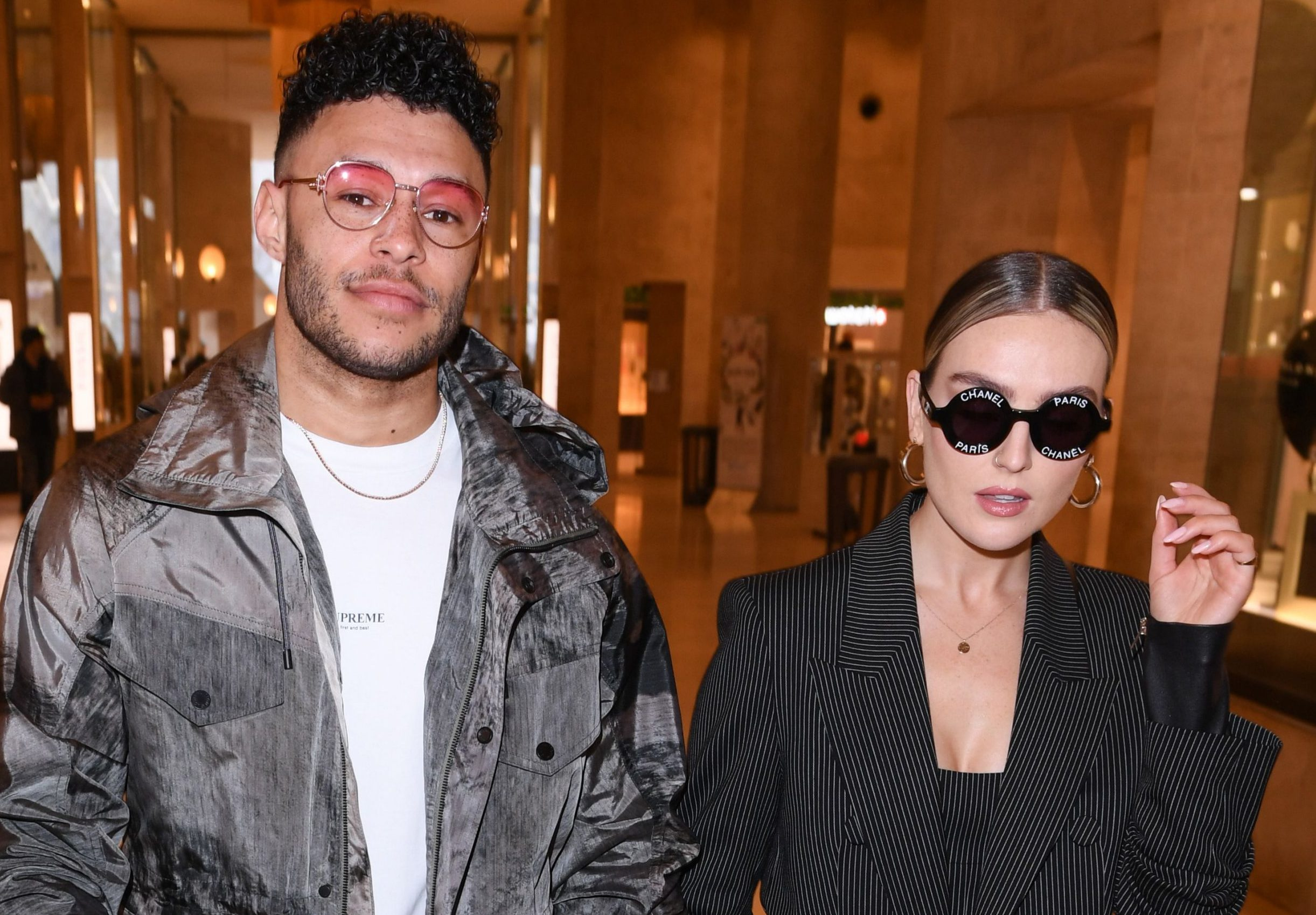 Perrie Edwards and Alex Oxlade-Chamberlain make play to be new Posh and Becks at Paris Fashion Week