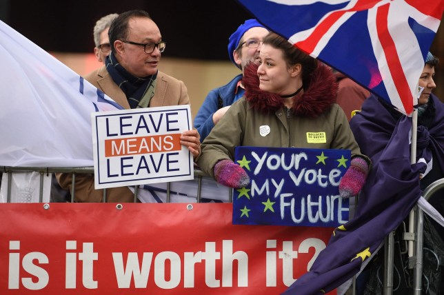 A pro-Brexit protester (L) interacts with a supporter of a second EU referendum (R) outside the Houses of Parliament in central London on January 15, 2019. - Parliament is to finally vote today on whether to support or vote against the agreement struck between Prime Minister Theresa May's government and the European Union. (Photo by Oli SCARFF / AFP)OLI SCARFF/AFP/Getty Images