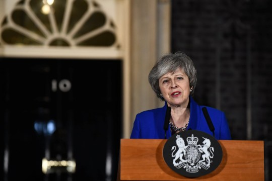 Britain's Prime Minister Theresa May makes a statement following winning a confidence vote, after Parliament rejected her Brexit deal, outside 10 Downing Street in London, Britain, January 16, 2019. REUTERS/Clodagh Kilcoyne
