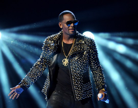"""FILE - In this June 30, 2013 file photo, R. Kelly performs at the BET Awards in Los Angeles. Multiple outlets have reported that Sony Music has dropped embattled R&B star R. Kelly from its roster. The announcement comes two weeks after the popular documentary series """"Surviving R. Kelly"""" recently drew fresh attention to the sex abuse allegations against R. Kelly, which has dogged him most of his career. (Photo by Frank Micelotta/Invision/AP, File)"""