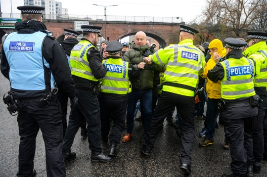 Police officers struggle to contain protesters as they attempt to block a major junction during a Brexit supporting 'Yellow Vest' protest through Leeds city centre this afternoon. The protest saw over 5 arrests by the police as roads were blocked off and traffic brought to a standstill. A counter protest from the Anti Fascist Leeds group also took place in the city centre - 19th January 2019