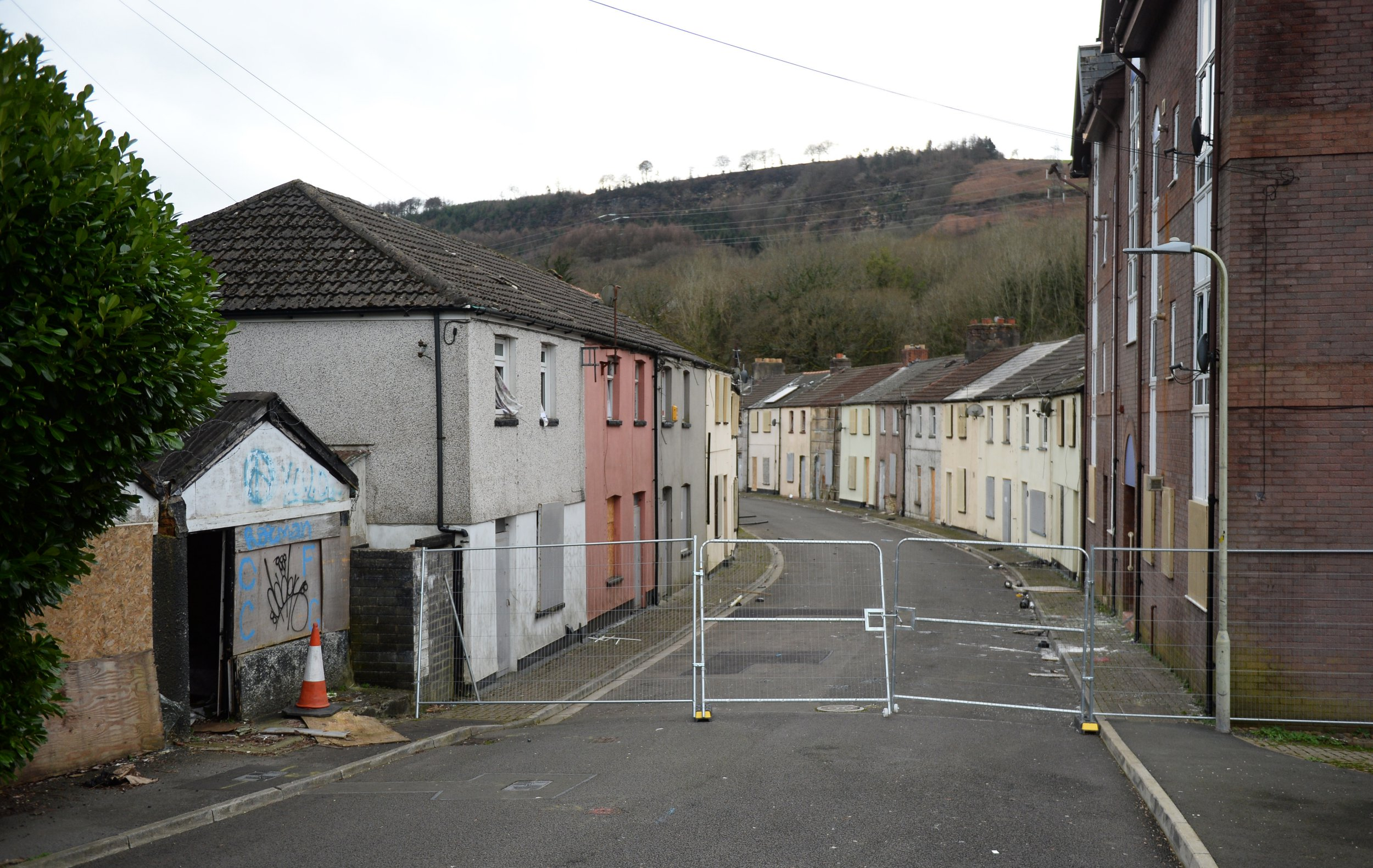 Two streets in a tiny Welsh village have been turned into a ghost town - after homeowners were forced to move out. More than 100 homes in the rows of traditional terraced houses stand eerily empty yards from a flowing river. And Taff Street in Merthyr Vale, South Wales, is now deserted after being repeatedly flooded by the river which gave it its name. ?? WALES NEWS SERVICE