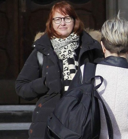 """Richard Gittins/Champion News: 07948286566 news@championnews.co.uk Picture shows animal-loving care home manager Kim Suttle, 54, outside London's High Court. She is in line for a ?100,000 payout after an online troll falsely accused her of kicking her own dog, sparking a """"viral hate comapaign."""""""