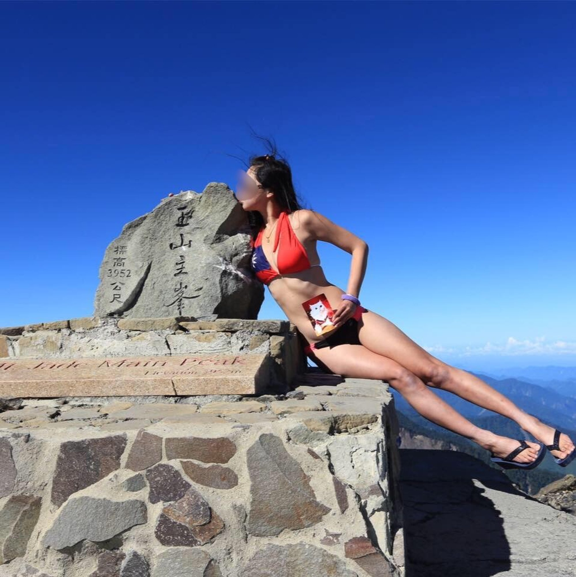 Pic shows: Gigi Wu is known for hiking in bikinis. TAIWAN: A mountaineer who was known for hiking in bikinis has tragically frozen to death while awaiting rescue following a 65-foot plunge into ravine and a satellite-phone call for help.