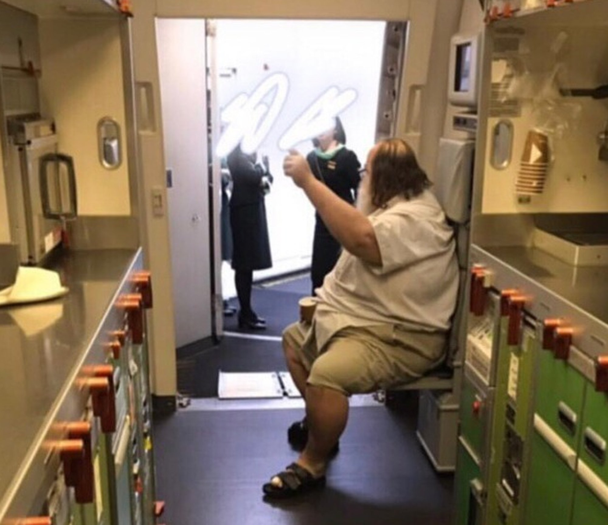 Pic shows: The accused passenger on the EVA Air flight to Taiwan. TAIWAN: A flight attendant has been left traumatised after a 31-stone passenger allegedly forced her and her colleagues to undress him in a lavatory and wipe his backside during a long-haul flight from the United States.