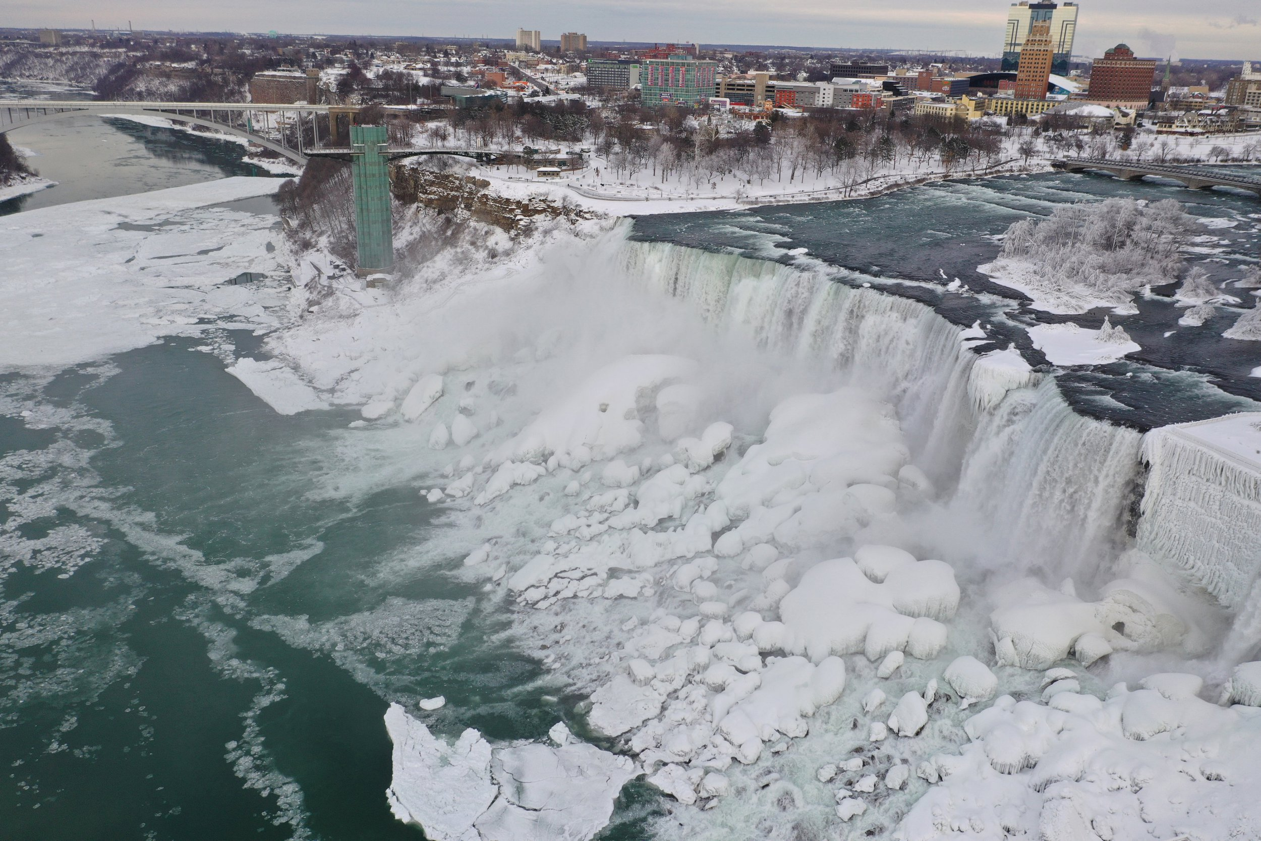 An aerial photo taken over the American side shows water flowing around ice due to subzero temperatures in Niagara Falls, New York, U.S. January 22, 2019. REUTERS/Dronebase MANDATORY CREDIT