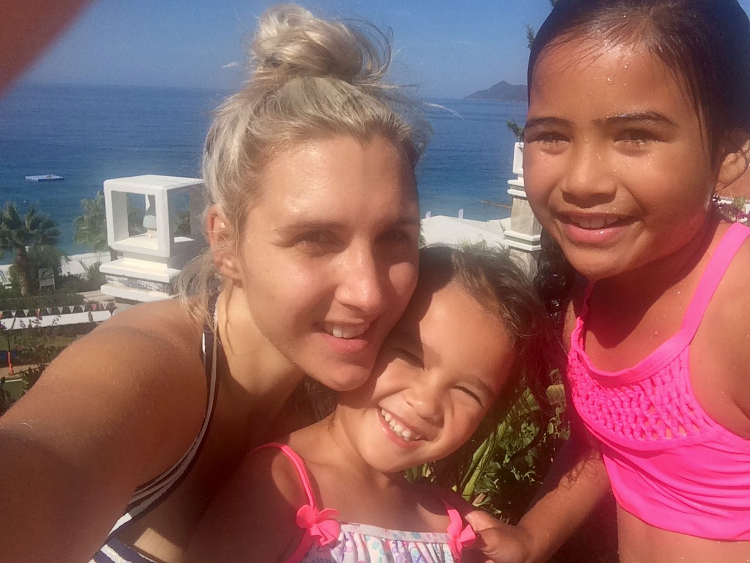 PIC FROM Caters News - (PICTURED: Jemma Joslyn, 32, from Seaford, East Sussex, with her daughters when they were on holiday in Turkey *Jemma does not want her kids to be named*) - A mum-of-two has narrowly avoided DEATH on holiday after being squashed by an obese woman on a waterslide.Jemma Joslyn, 32, paid 2700 for an all inclusive two-week holiday at Liberty Lykia Hotel, Turkey, last September with her two children before it turned into a living nightmare. After using the five star hotels onsite water park, Jemma was left fighting for her life after she claims another holiday-maker hurtled down the water slide and crushed her internal organs.SEE CATERS COPY