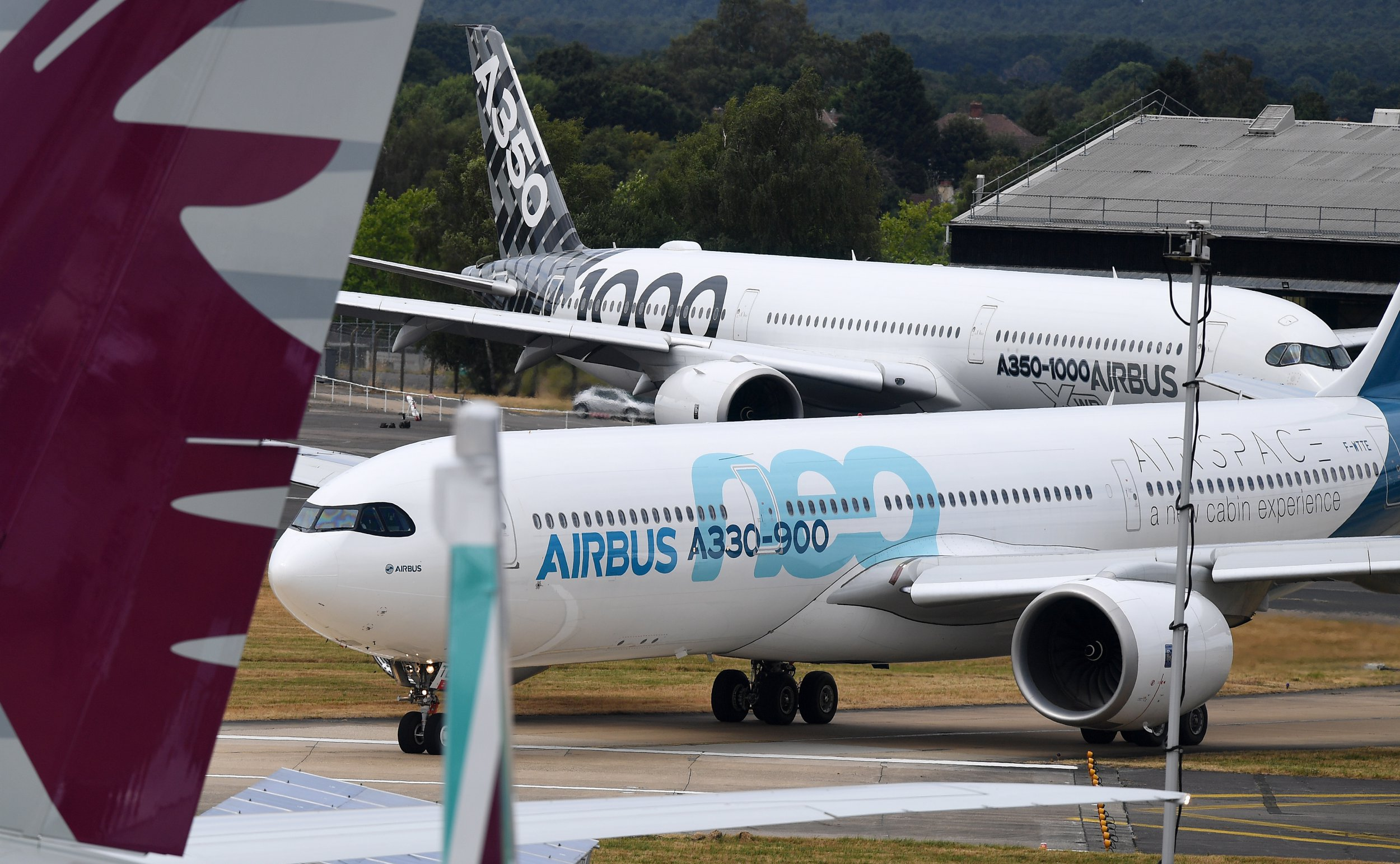 epa07314835 (FILE) - An Airbus A330-900 neo (front) and an A350-1000 XWB (behind) taxi to the runway at the Farnborough International Airshow (FIA2018), in Farnborough, Britain, 17 July 2018 (reissued 24 January 2019). Reports on 24 January 2019 state Airbus' chief executive Tom Enders has said Airbus, that employs 14,000 staff in UK, 'will have to make potentially very harmful decisions for the UK' in case of a no-deal Brexit. The company said it could move the wing-construction out from UK if no deal on Brexit will be reached. EPA/ANDY RAIN