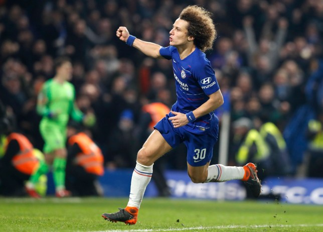 Chelsea's David Luiz celebrates after scoring the winning penalty during the second leg of the English League Cup semifinal soccer match between Chelsea and Tottenham Hotspur at Stamford Bridge stadium in London, Thursday, Jan. 24, 2019. (AP Photo/Alastair Grant)