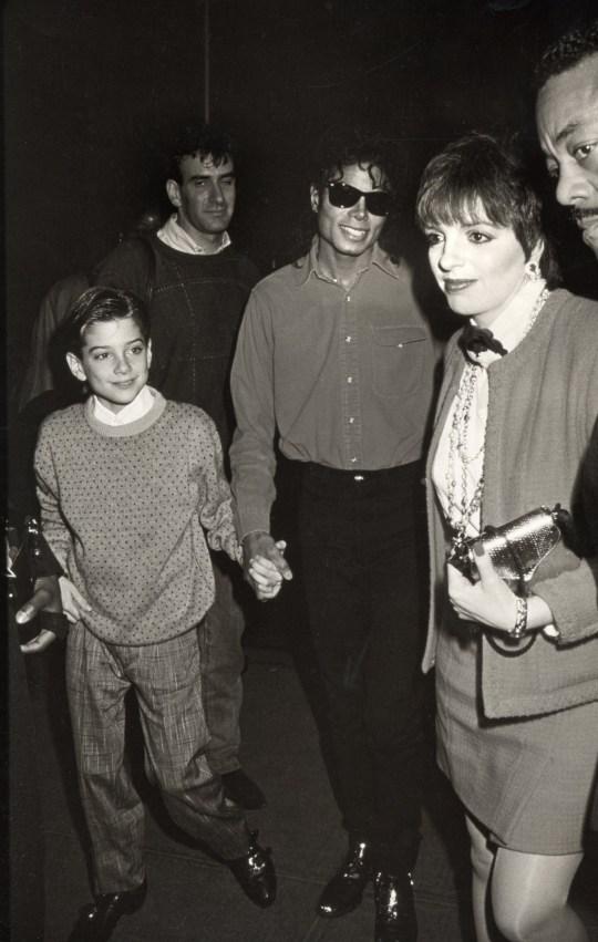 6e868b6e Jimmy Safechuck, Michael Jackson and Liza Minnelli (Photo by Ron  Galella/WireImage)