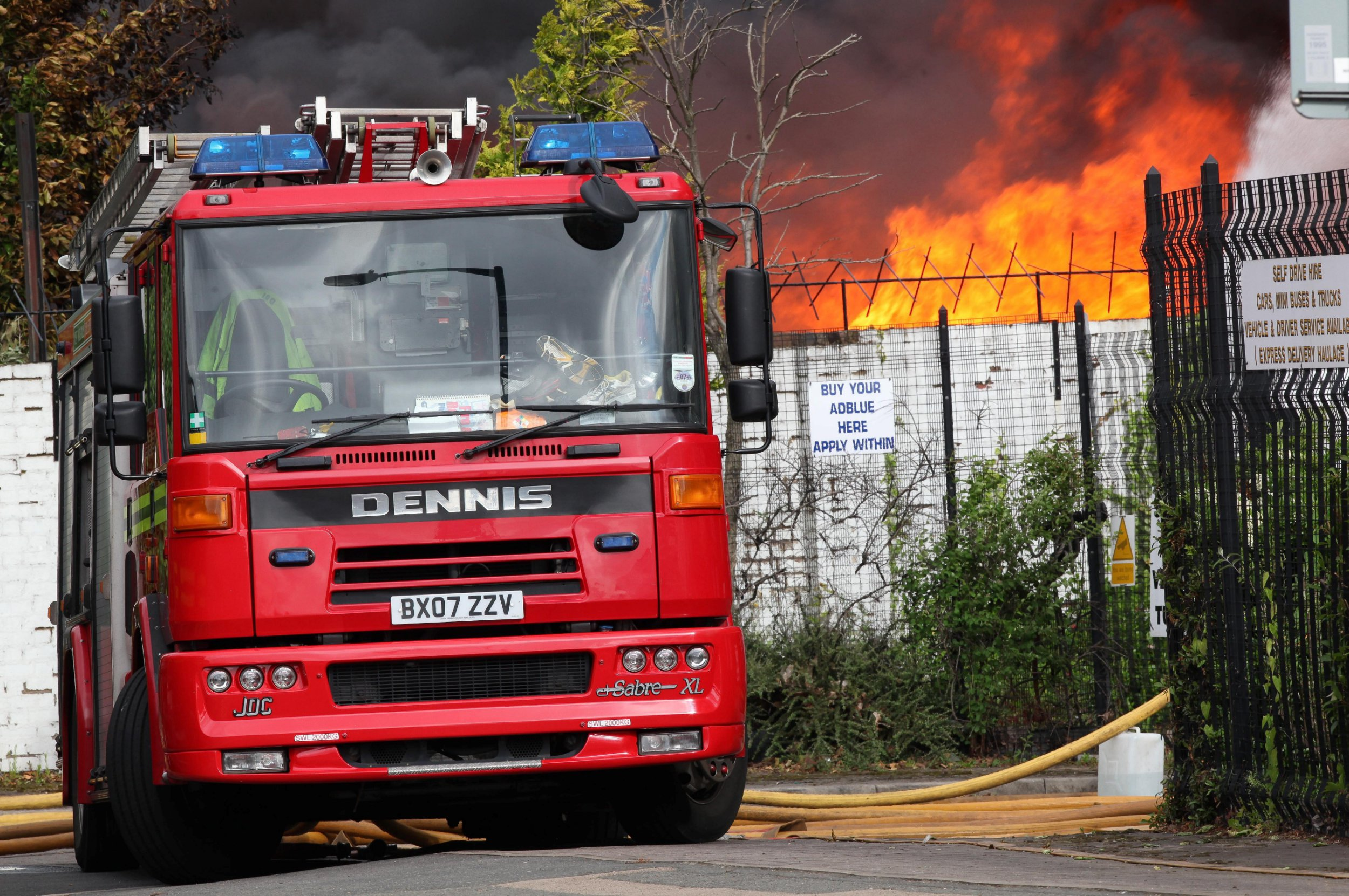 FILE PICTURE - Firefighters tackle a blaze involving 100,000 tonnes of plastic recycling material at a factory in Dartmouth Road, Smethwick, West Midlands. One of the county's biggest fire services has been accused of discrimination after it emerged white men have to score higher in its recruitment tests than anyone else. See SWNS story SWSYfire. West Midlands Fire and Rescue Service wants 60 per cent of new recruits to be women, and 35 per cent to be from black and minority ethnic groups by 2021. In a bid to reach the target, they have altered the pass rates to make it easier for people from those groups to get through the test. Women and men from black, Asian and minority ethnic groups only have to score 60 per cent on verbal and numerical tests - where as white men have to score 70 per cent.