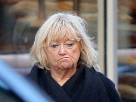 Judy Finnigan looks downcast as she's seen alone after 'nearly dying from taking Ibuprofen'