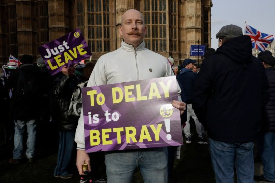 A leave supporter takes part in a demonstration near the Parliament in London, Tuesday, Jan. 29, 2019. With Britain's House of Commons bitterly divided on the way forward for Britain's departure from the European Union, lawmakers representing various factions are vying to have their say in the Brexit process after they overwhelmingly rejected the government's divorce agreement two weeks ago. (AP Photo/Matt Dunham)