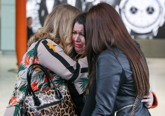 Laura Plummer (centre) is embraced by her sisters Lynda (left) and Rachel at Heathrow airport following her return to the UK after being released from a prison sentence in Egypt. PRESS ASSOCIATION Photo. Picture date: Tuesday January 29, 2019. Ms Plummer, 34, from Hull, was sentenced to three years in prison on Boxing Day 2017 for taking 290 Tramadol tablets into the country. See PA story COURTS Egypt. Photo credit should read: Andrew Matthews/PA Wire