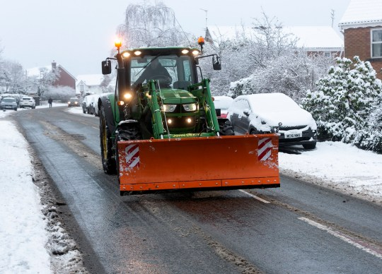 White Wednesday... A road gritter clears the main roads in Rochdale, Greater Manchester today. A yellow warnings for snow and ice has hit Lancashire and Greater Manchester today. The weather warning is expected to last until the weekend as un to 4 inches of snow is expected.