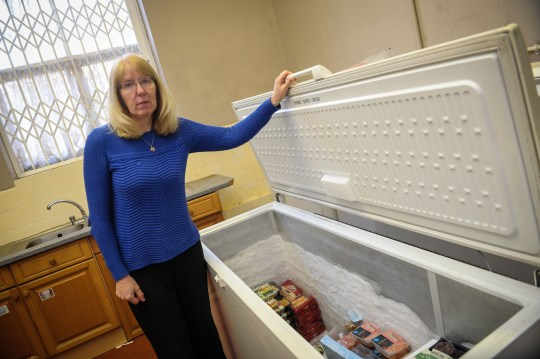 """A food bank was raided by thieves who then switched off the freezers """"out of spite"""". The shameless burglars stole a mountain of food destined for Grimsby's most vulnerable. Caption: Counting the cost, Rock Foundation founder Pam Hodge reacts to the theft on food and drink produce from their food bank based at Holme Hill School in Grimsby."""