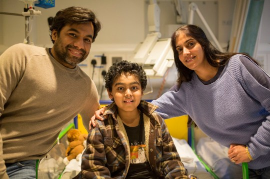 Undated handout photo issued by Great Ormond Street Hospital of Yuvan Thakkar (centre), his father Vinay and his mother Sapna. Yuvan, 11, has become the first NHS patient to receive a pioneering new cancer therapy that uses the body?s own immune system to fight the disease. PRESS ASSOCIATION Photo. Issue date: Thursday January 31, 2019. Thakkar, from Watford, received the drug Kymriah, a type of immunotherapy called CAR-T cell therapy, at Great Ormond Street Hospital (GOSH) in London last week. See PA story HEALTH Therapy. Photo credit should read: Great Ormond Street Hospital/PA Wire NOTE TO EDITORS: This handout photo may only be used in for editorial reporting purposes for the contemporaneous illustration of events, things or the people in the image or facts mentioned in the caption. Reuse of the picture may require further permission from the copyright holder.