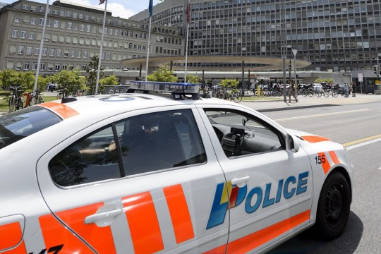 """A police car is seen at the entrance of the Geneva University Hospital (HUG) on May 31, 2015 in Geneva, where US Secretary of State John Kerry has been hospitalized after breaking his leg. Kerry broke his leg in a cycling accident in France on Sunday, his spokesman said, adding that he was in """"stable condition"""" and will return to the United States for treatment. AFP PHOTO / FABRICE COFFRINI (Photo credit should read FABRICE COFFRINI/AFP/Getty Images)"""