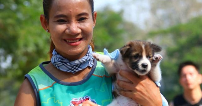 METRO GRAB - taken from the Facebook of Polsin Sinsamoe without permission Woman finishes marathon holding puppy she rescued along the wayhttps://www.facebook.com/photo.php?fbid=2195370500791870&set=pcb.2195370797458507&type=3&theaterCredit: Polsin Sinsamoe