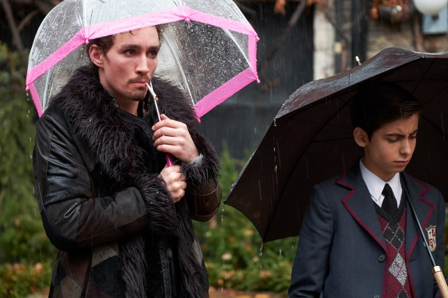 robert sheehan as klaus and aidan gallagher as number 5 in the umbrella academy