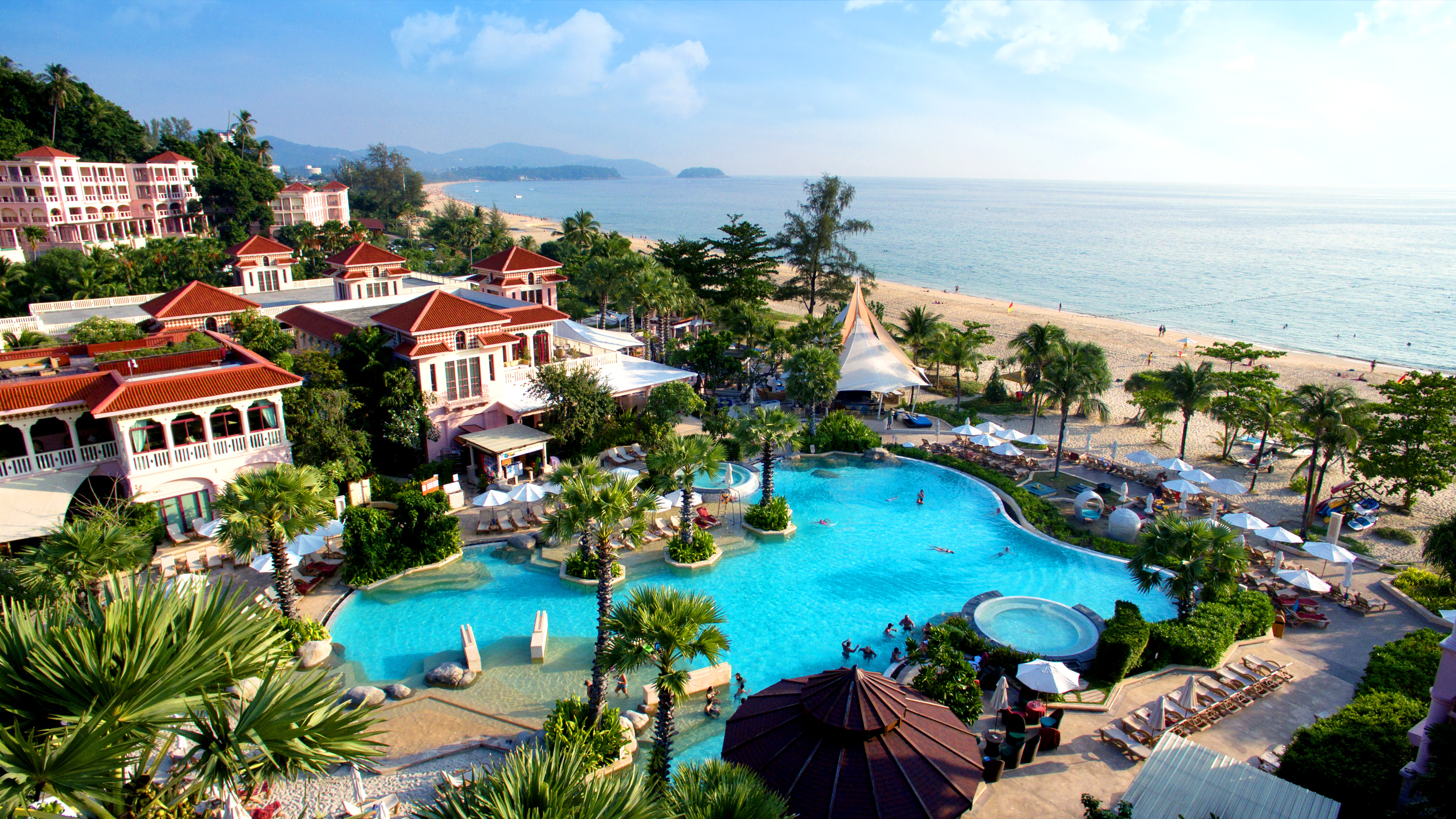 Shot of a Centara Resort with pool and the sea in the background