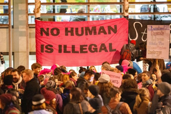 Sign at protest saying No Human Is Illegal