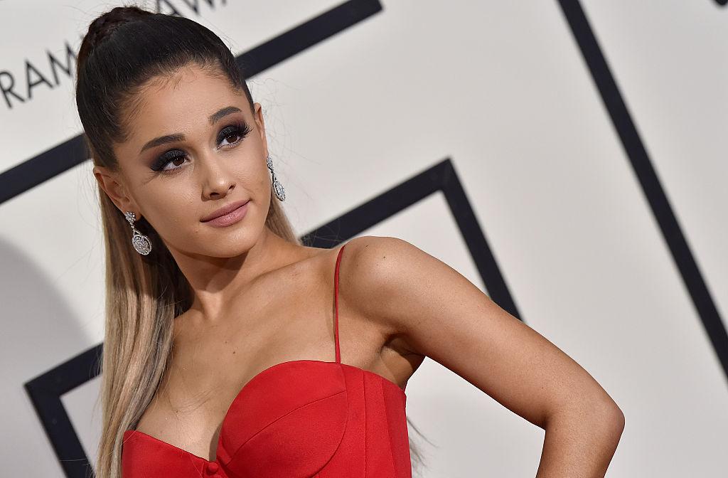 Arian Grande posing for photos at the 2016 Grammys