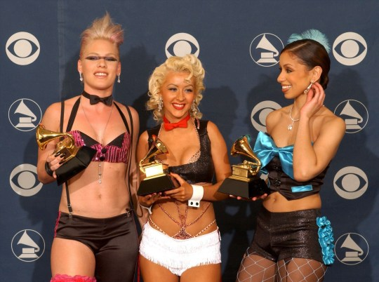 "44th Annual Grammy Awards...401611 76: (L to R) Singers Pink, Christina Aguilera and Mya hold their Best Pop Collaboration With Vocals for ""Lady Marmalade"" award backstage during the 44th Annual Grammy Awards at Staples Center February 27, 2002 in Los Angeles, CA. (Photo by Vince Bucci/Getty Images)...ACE...Entertainment...Los Angeles...CA...United States...BACKSTAGE BOOTS BOWTIE BRAS CALIFORNIA CELEBRITY ENTERTAINMENT FASHION FISHNET STOCKINGS GRAMMY AWARDS GRAMMYS LADY MARMALADE LINGERIE MOULIN ROUGE MUSIC STAPLES CENTER UNDERWEAR"