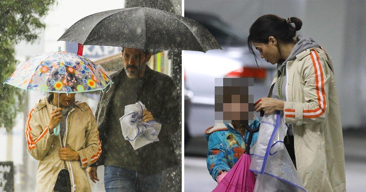Jenna Dewan and boyfriend Steve Kazee brave heavy rain to run errands with her daughter Everly