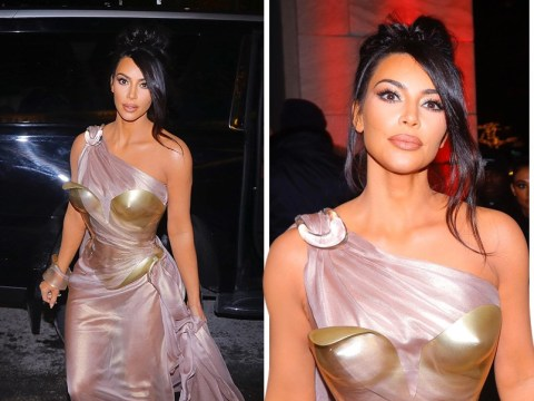 Kim Kardashian gives Wonder Woman run for her money as she rocks breastplate at fashion exhibit