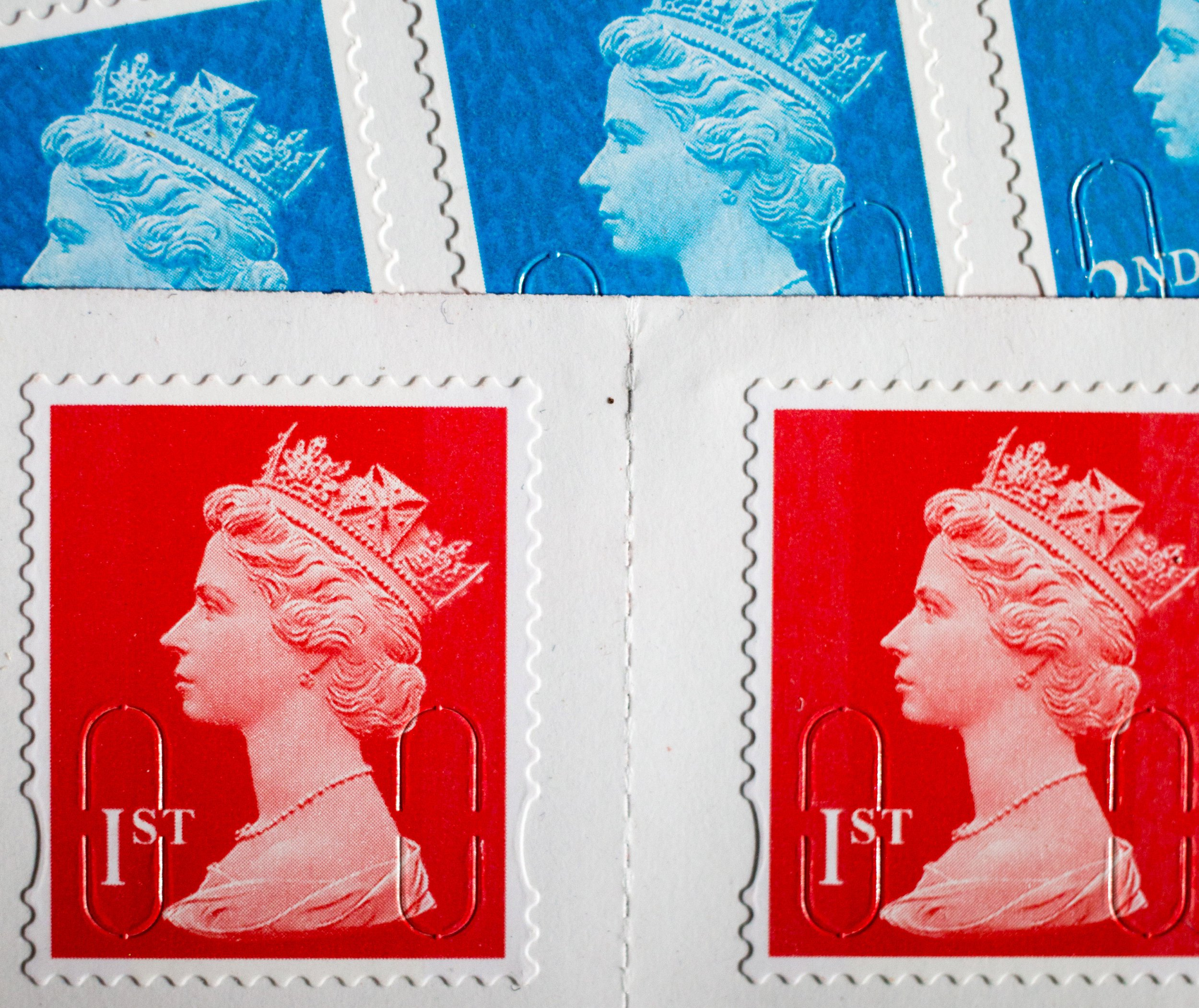 BATH, ENGLAND - FEBRUARY 29: In this photo illustration first and second class postage stamps are displayed on February 29, 2016 in Bath, England. Royal Mail, recently privatised, is set to raise the price of stamps by 1p. The increases that take affect from 29 March, will mean a first class stamp will now cost 64p and a second class stamp will now be 55p. (Photo by Matt Cardy/Getty Images)