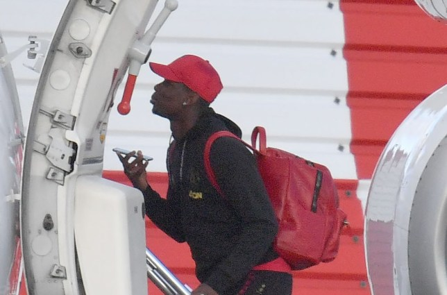 Pics Paul Cousans/Zenpix Ltd Man Utd players board the 15 min flight to Leicester today Poignant on his mobile